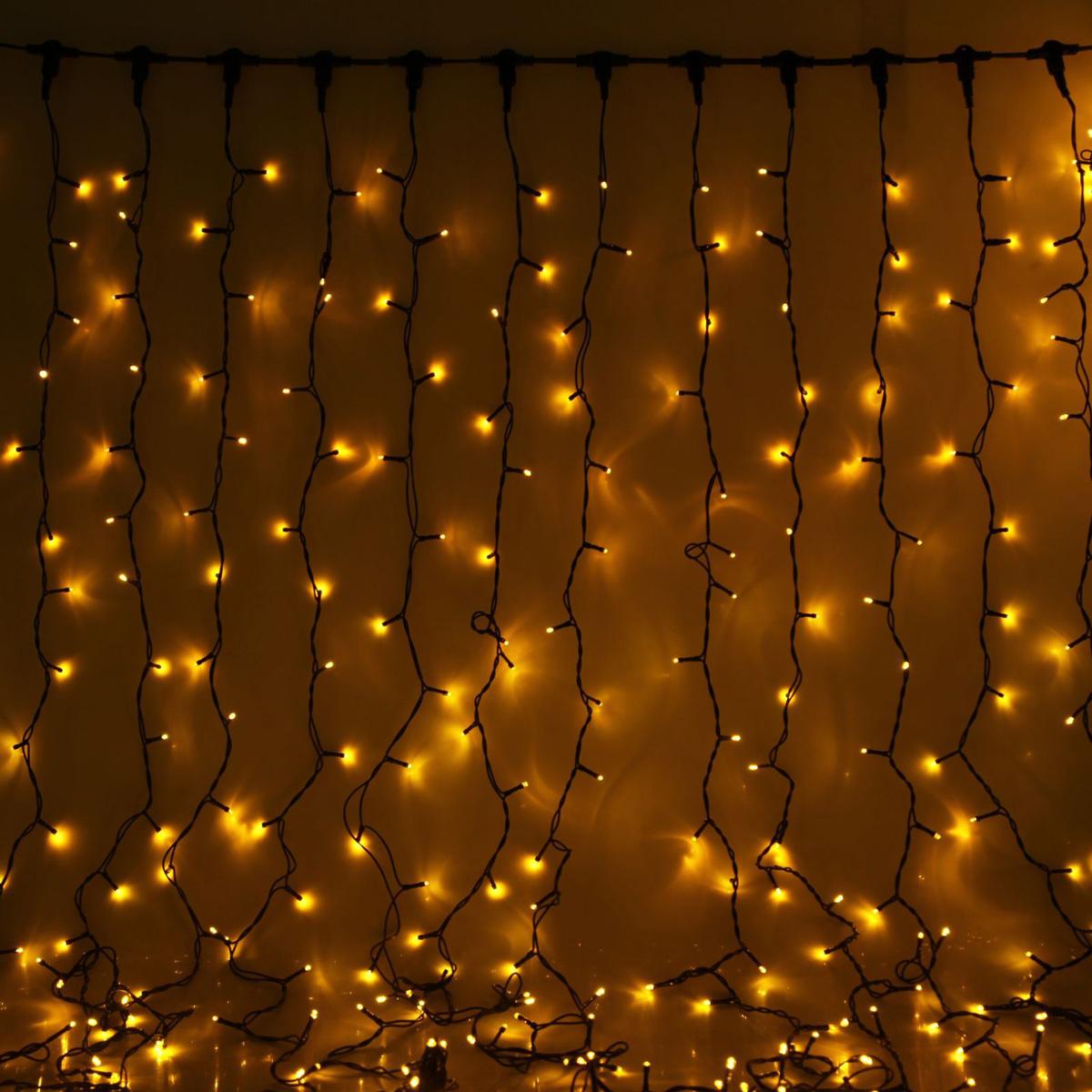 Гирлянда светодиодная Luazon Занавес, цвет: желтый, уличная, 1440 ламп, 220 V, 2 х 6 м. 10802831080283Светодиодные гирлянды и ленты — это отличный вариант для новогоднего оформления интерьера или фасада. С их помощью помещение любого размера можно превратить в праздничный зал, а внешние элементы зданий, украшенные ими, мгновенно станут напоминать очертания сказочного дворца. Такие украшения создают ауру предвкушения чуда. Деревья, фасады, витрины, окна и арки будто специально созданы, чтобы вы украсили их светящимися нитями.