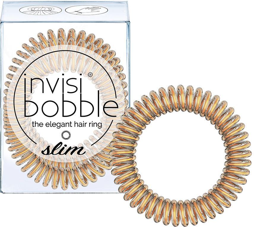 Invisibobble Резинка-браслет для волос Slim Bronze Me Pretty, 3 шт3097Резинки invisibobble SLIM в оттенке Bronze Me Pretty подойдут тем, кто действительно следит за модными тенденциями! Ярко-розовый цвет - вчерашний день. Бронзовый гораздо красивее, и оттенок Pretty in Bronze (мерцающий бронзовый) это доказывает! Резинки-браслеты invisibobble SLIM имеют увеличенное количество завитков, чем invisibobble ORIGINAL, а также уменьшенные в размере витки. Резинки invisibobble подходят для всех типов волос, надежно фиксируют причёску, не оставляют заломы и не вызывают головную боль благодаря неравномерному распределению давления на волосы. Кроме того, резинки-браслеты invisibobble не намокают и не вызывают аллергию при контакте с кожей, поскольку изготовлены из искусственной смолы.Вы можете легко и быстро создать стильную причёску, используя резиночку invisibobble. Если надеть резинку invisibobble SLIM как браслет, резиночка всегда будет с вами и не потеряется!