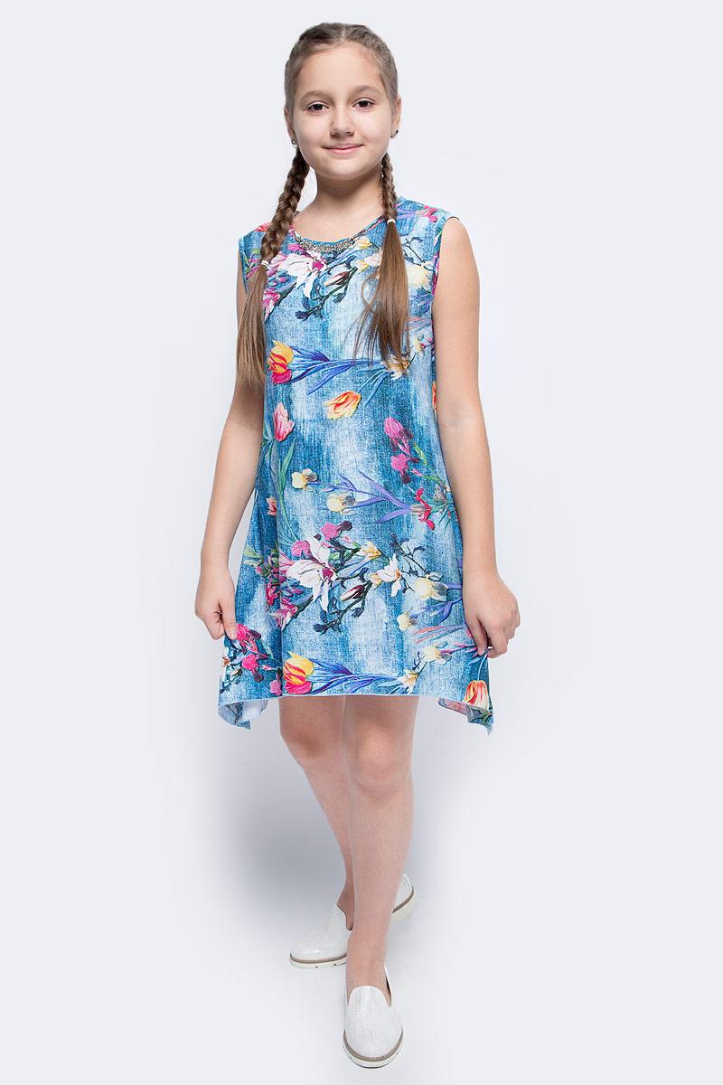 Туника для девочки M&D, цвет: синий, мультиколор. SWT27075S11. Размер 158SWT27075S11Туника для девочки от M&D изготовлена из натурального хлопка и оформлен цветочным принтом. Модель с круглым вырезом горловины имеет свободный крой.