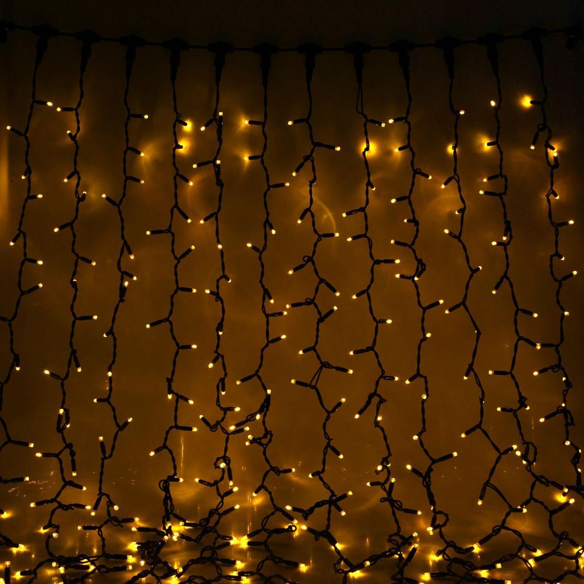 Гирлянда светодиодная Sima-land Занавес, цвет: желтый, уличная, 760 ламп, 220 V, 2 х 3 м. 23328562332856Светодиодные гирлянды и ленты — это отличный вариант для новогоднего оформления интерьера или фасада. С их помощью помещение любого размера можно превратить в праздничный зал, а внешние элементы зданий, украшенные ими, мгновенно станут напоминать очертания сказочного дворца. Такие украшения создают ауру предвкушения чуда. Деревья, фасады, витрины, окна и арки будто специально созданы, чтобы вы украсили их светящимися нитями.