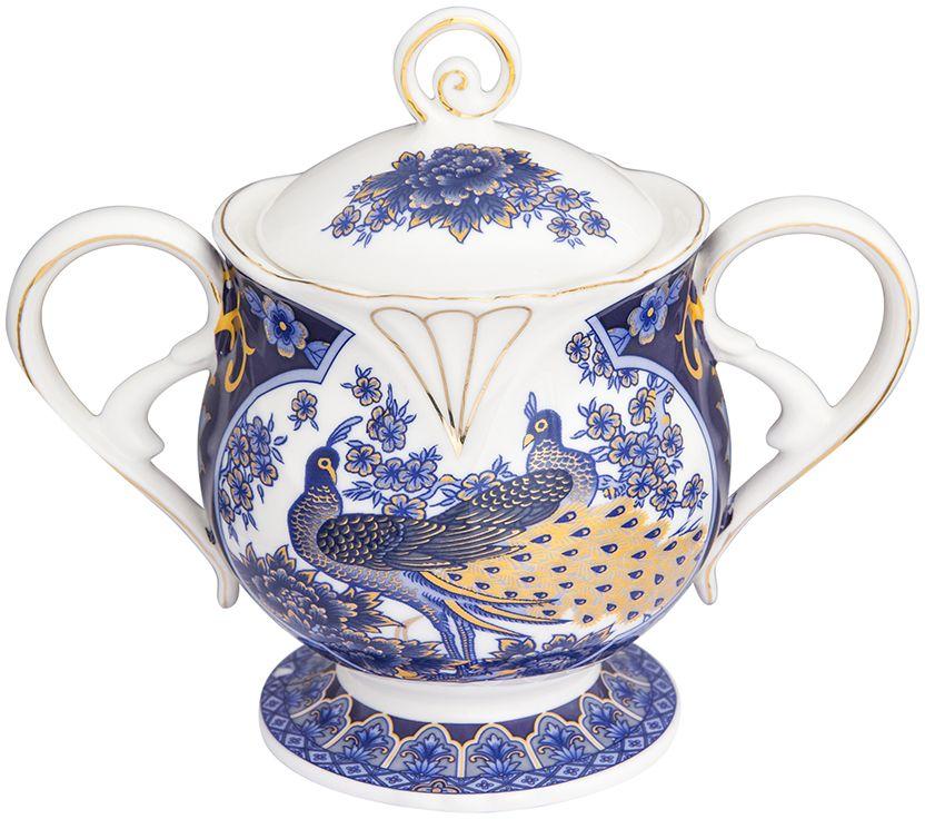 Сахарница Elan Gallery Павлин, с крышкой, цвет: синий, 16 х 9,5 х 13,5 см180954Сахарница Elan Gallery с крышкой изготовлена из фарфора и оформлена принтом. Емкость универсальна, подойдет как для сахара, так и для специй или меда.