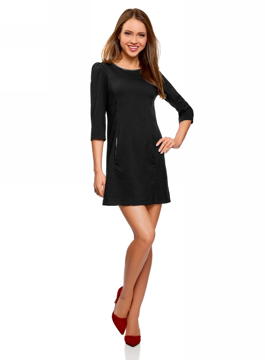 Платье oodji Ultra, цвет: черный. 12C02003-1/47406/2929D. Размер 38 (44-170)12C02003-1/47406/2929DМодное платье от oodji выполнено из высококачественного текстиля с отделкой из искусственной кожи. Модель с круглым вырезом горловины и рукавами 3/4 на спинке застегивается на потайную молнию.