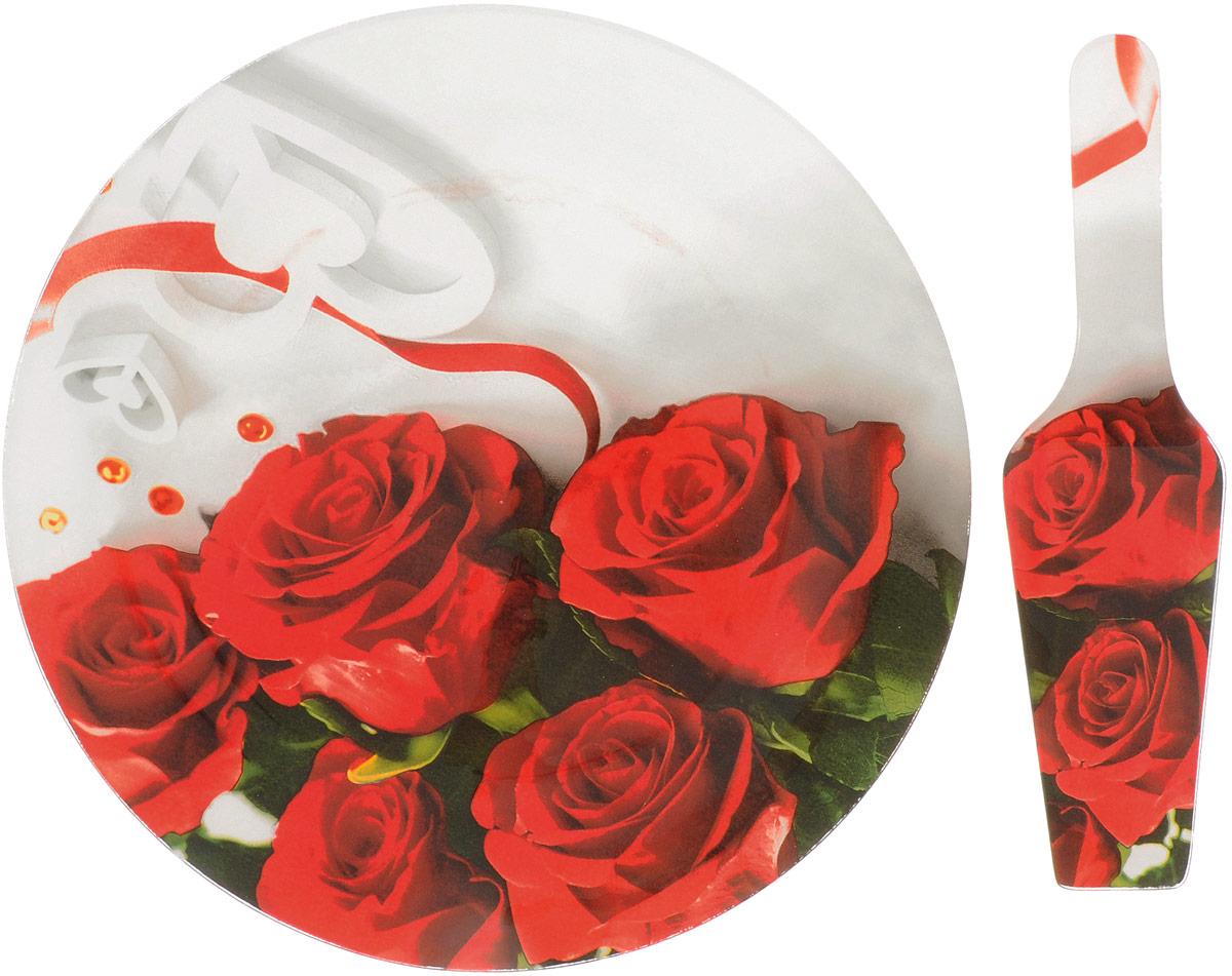 Блюдо для торта Loraine Розы, с лопаткой, диаметр 30,5 см26630-3_красные розыБлюдо для торта Loraine Розы выполнено из высококачественного закаленного стекла и оформлено ярким рисунком с изображением роз.Изделие идеально подойдет для сервировки не только торта и десертов, но и различных закусок.Изделие обладает непористойповерхностью и не впитывает запахи.Оригинальная и стильная тортовница станет достойным украшением вашего праздничного стола. Диаметр: 30,5 см Длина лопатки: 26,5 см