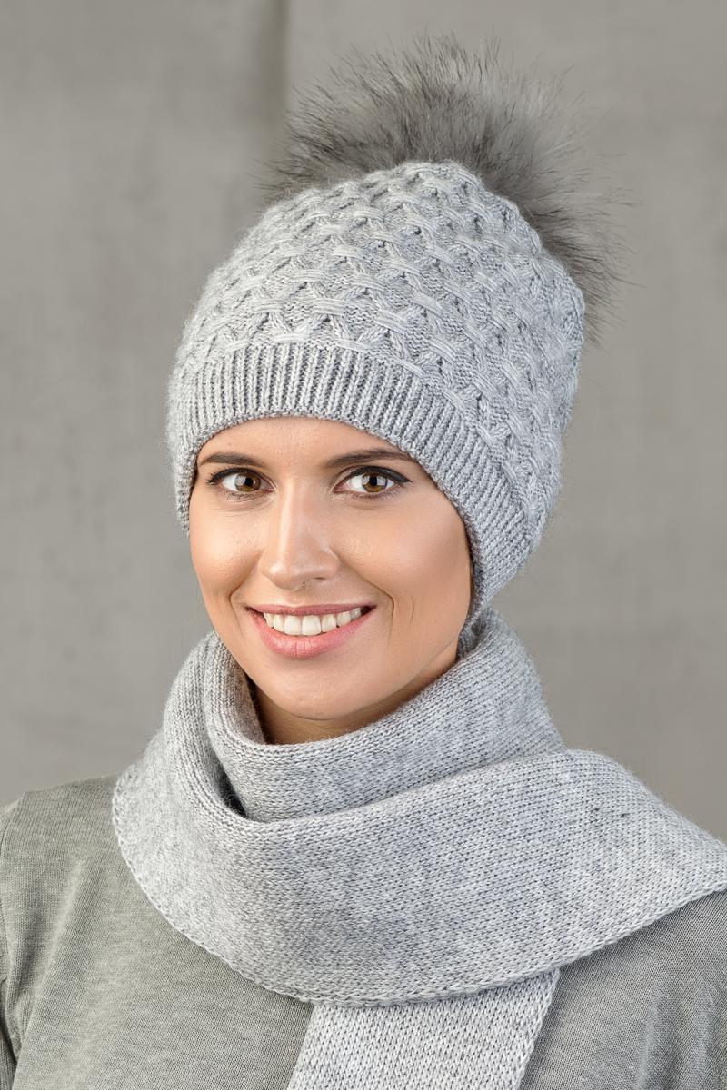 Шапка женская Nuages, цвет: серый. NH-742/125. Размер универсальныйNH-742/125Теплая зимняя женская вязаная шапка от Nuages двойной вывязки выполнена из хлопково-акриловой пряжи. Помпон из искусственного меха. Такая шапка согреет вас в холодное время года и станет отличным дополнением к любому вашему образу.