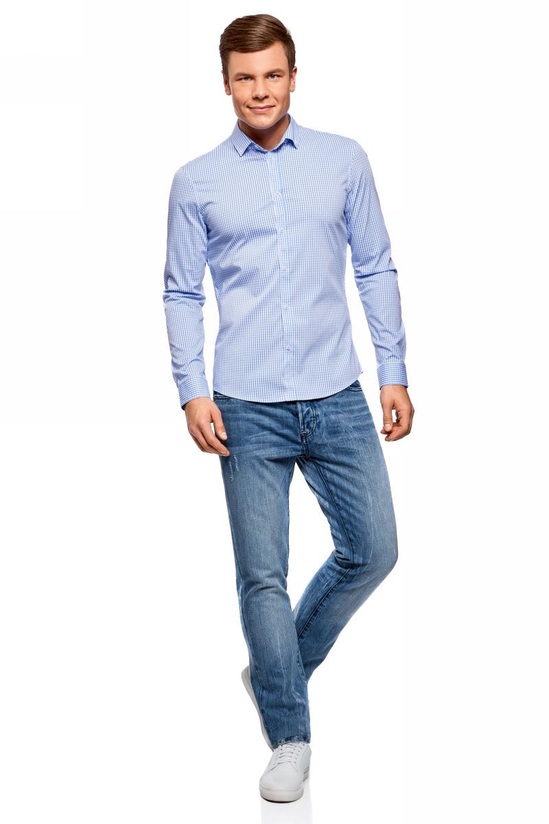 Рубашка мужская oodji Basic, цвет: белый, голубой. 3B140003M/39767N/1070C. Размер 39-182 (46-182)3B140003M/39767N/1070CМужская рубашка oodji Basic выполнена из хлопка с добавлением полиамида и эластана. Рубашка с длинными рукавами и отложным воротником застегивается на пуговицы спереди. Манжеты рукавов также застегиваются на пуговицы. Рубашка оформлена принтом в мелкую клетку.