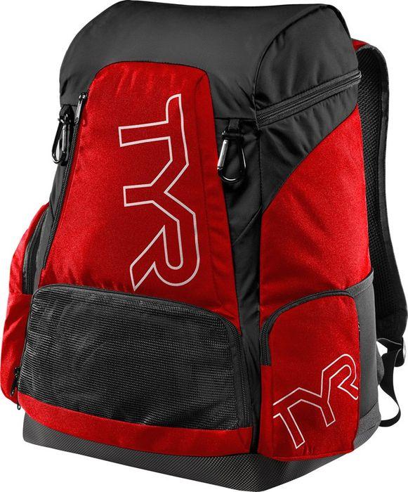 Рюкзак Tyr Alliance 45L Backpack, цвет: красный, черный. LATBP45LATBP45Рюкзак TYR Alliance 45L Backpack – новая версия рюкзака Alliance Team Backpack 2 с более современным дизайном и увеличенным рабочим пространством. Рюкзак сконструирован для пловцов: есть отделение для влажных и сухих вещей, имеются передние и боковые карманы, защитное пространство для крупной электроники, регулируемые ремни, 2 карабина-крючка для подвешивания вещей или сеток.Рюкзак разработан с использованием технологичных тканей, чтобы обеспечить легкость, прочность и водостойкость.