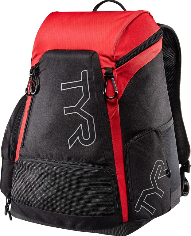 Рюкзак Tyr Alliance 30L Backpack, цвет: черный, красный. LATBP30LATBP30Рюкзак TYR Alliance 30L Backpack – новая версия рюкзака Alliance Team Mini Backpack с более современным дизайном и увеличенным рабочим пространством. Рюкзак сконструирован для пловцов: есть отделение для влажных и сухих вещей, имеются передние и боковые карманы, защитное пространство для крупной электроники, регулируемые ремни, 2 карабина-крючка для подвешивания вещей или сеток.Рюкзак разработан с использованием технологичных тканей, чтобы обеспечить легкость, прочность и водостойкость.