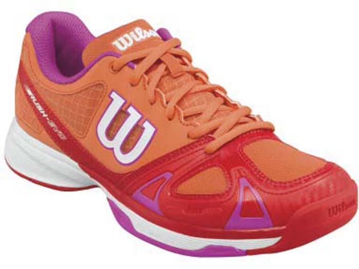 Кроссовки для тенниса женские Wilson Rush Evo W Nasturtium, цвет: оранжевый. WRS322270. Размер 7 (40)WRS322270Женские кроссовки для тенниса от Wilson - это идеальный вариант для тех, кто ценит в обуви комфорт, поддержку и долговечность. Модель создана специально для любителей, которые хотят достичь заметных результатов в теннисе.Верх модели выполнен из искусственной кожи со вставками из дышащего текстиля и оформлен названием и логотипом бренда. Классическая шнуровка гарантирует удобство и надежно фиксирует модель на ноге. Технология 2D-F.S: полиуретановый штамп в носовой части обеспечивает повышенную устойчивость. Технология Dynamic Fit - DF2: высота средней части подошвы - 9 мм. Технология R-DST: вставка из химически активных веществ в пяточной части обеспечивает максимальную амортизацию. Съемная стелька EVA с внешней текстильной поверхностью обеспечивает комфорт. Резиновая рельефная подошва обеспечивает отличное сцепление с поверхностью. В таких кроссовках вашим ногам будет комфортно и уютно.