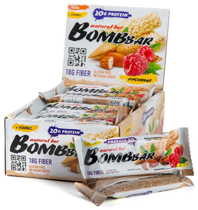 Батончик протеиновый Bombbar, рисовый, 20 шт х 60 г14620020960608Bombbar - это спортивный батончик с высоким содержанием протеина и минимальным количеством сахара. Обладает восхитительным вкусом, быстро снабжает организм многокомпонентным протеином, отлично подходит для белковой диеты.Протеиновый батончик Bombbar:- поможет снизить вес,- питает мышечную массу,- придает эффект сытости,- улучшает общее состояние системы пищеварения,- способствует росту полезной микрофлоры,- способствует подержанию здорового уровня сахара в крови,- не содержит сахар,- не содержит ГМО.Состав: белки 38% (концентрат сывороточного белка, концентрат молочного белка), изомальтоолигосахарид , вода, рис взорванный, эквивалент масла какао, малина, миндаль дробленый, агенты влагоудерживающие (глицерин, сорбитол), соль, натуральные ароматизаторы, регулятор кислотности - лимонная кислота, аскорбиновая кислота (витамин С), консервант - сорбат калия, подсластитель - стевиозид.Как повысить эффективность тренировок с помощью спортивного питания? Статья OZON Гид