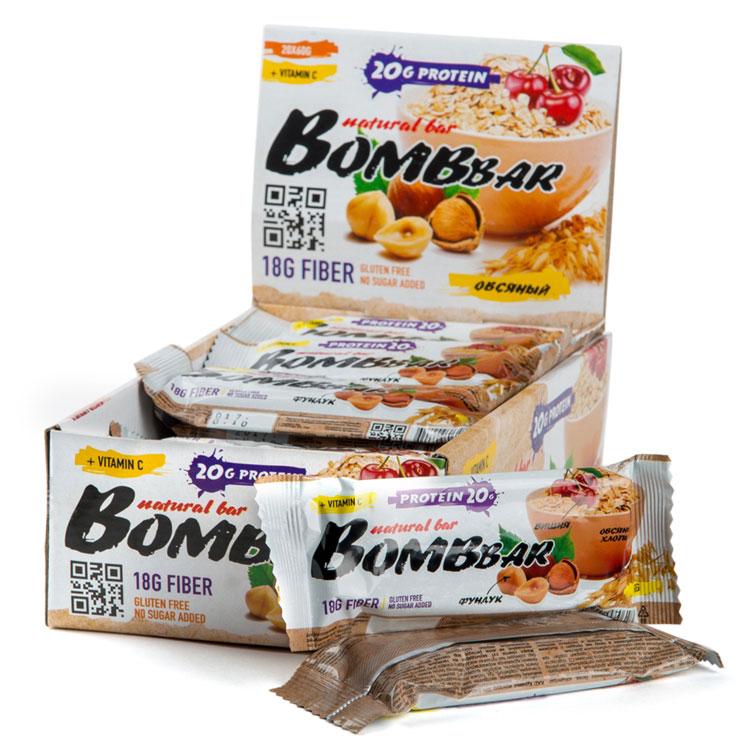 """""""Bombbar"""" - это спортивный батончик с высоким содержанием протеина и минимальным количеством сахара. Обладает восхитительным вкусом, быстро снабжает организм многокомпонентным протеином, отлично подходит для белковой диеты.Протеиновый батончик """"Bombbar"""":- поможет снизить вес,- питает мышечную массу,- придает эффект сытости,- улучшает общее состояние системы пищеварения,- способствует росту полезной микрофлоры,- способствует подержанию здорового уровня сахара в крови,- не содержит сахар,- не содержит ГМО.Состав: белки 39% (концентрат сывороточного белка, концентрат молочного белка), изомальтоолигосахарид , овсянка взорванная, вода, эквивалент масла какао, вишня, фундук дробленый, агенты влагоудерживающие (глицерин, сорбитол), соль, ароматизаторы натуральные, регулятор кислотности - лимонная кислота, аскорбиновая кислота (витамин С), консервант - сорбат калия, подсластитель - стевиозид.  Как повысить эффективность тренировок с помощью спортивного питания? Статья OZON Гид"""