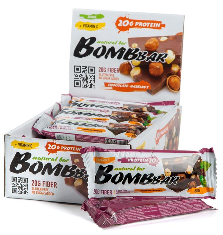 """""""Bombbar"""" - это спортивный батончик с высоким содержанием протеина и минимальным количеством сахара. Обладает восхитительным вкусом, быстро снабжает организм многокомпонентным протеином, отлично подходит для белковой диеты.Протеиновый батончик """"Bombbar"""":- поможет снизить вес,- питает мышечную массу,- придает эффект сытости,- улучшает общее состояние системы пищеварения,- способствует росту полезной микрофлоры,- способствует подержанию здорового уровня сахара в крови,- не содержит сахар,- не содержит ГМО.Состав: белки 40 % (концентрат сывороточного белка, концентрат молочного белка), изомальтоолигосахарид , вода, фундук жареный, эквивалент масла какао, шоколад (сахар, какао-масса, какао-масло, эмульгатор (соевый лецитин)), како порошок натуральный, агент влагоудерживающий (глицерин, сорбитол), соль, ароматизаторы натуральные, регулятор кислотности - лимонная кислота, аскорбиновая кислота(витамин С), подсластитель - стевиозид.  Как повысить эффективность тренировок с помощью спортивного питания? Статья OZON Гид"""