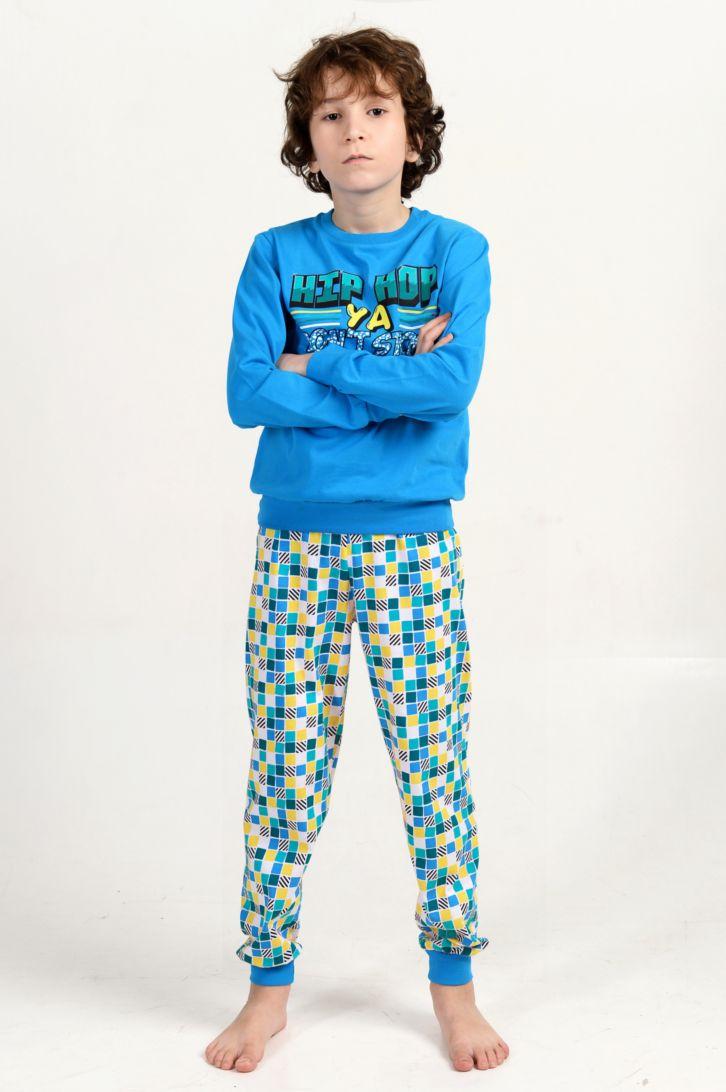Пижама для мальчика Melado Хип-Хоп, цвет: бирюзовый, голубой. MK2643/01. Размер 152MK2643/01Удобная пижама для мальчика от Melado, состоящая из свитшота и брюк, изготовлена из натурального хлопка. Свитшот с длинными рукавами и круглым вырезом горловины спереди оформлен ярким принтом. Принтованные брюки с эластичной резинкой на талии. Манжеты рукавов и брючин, низ свитшота дополнены трикотажными резинками.