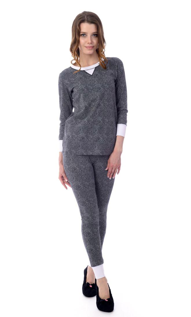 Пижама женская Melado Адель, цвет: черный. ML2853/01. Размер 46ML2853/01Теплая и уютная пижама- домашний комплект в оригинальной цветовой гамме. Футболка-свитшот с руками 3/4 и облегающие брюки-лосины создают необычный и стильный образ. Ворот, манжеты и низ брюк отделаны вставками из белоснежной резинки.