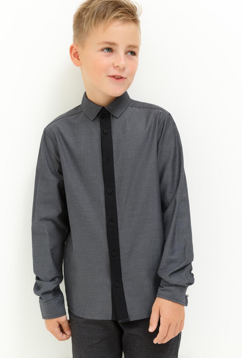 Рубашка для мальчика Acoola Steff, цвет: серый. 20110280060_1900. Размер 17020110280060_1900Рубашка для мальчика Acoola выполнена из натурального хлопка. Модель с классическим отложным воротником и длинными рукавами застегивается на пуговицы.