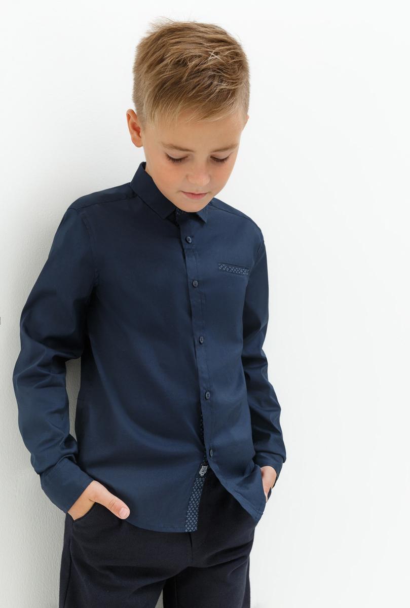 Рубашка для мальчика Acoola Enzo, цвет: темно-синий. 20110280062_600. Размер 15220110280062_600Рубашка для мальчика Acoola выполнена из хлопка с добавлением полиамида и эластана. Модель с классическим отложным воротником и длинными рукавами застегивается на пуговицы, на груди дополнена врезным карманом.