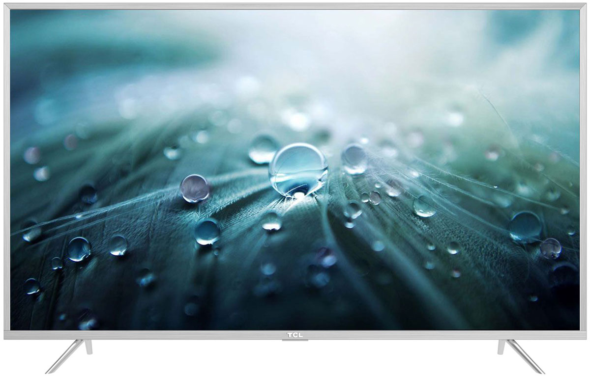 TCL L65P2US, Silver телевизорL65P2USНа экране телевизора TCL L65P2US вы всегда будете видеть идеальное изображение формата 4К, вне зависимости от качества видеосигнала. За его обработку отвечает высокопроизводительный 64-х битный процессор, автоматически анализирующий и конвертирующий картинку и звук. Загружайте новый контент, смотрите фильмы, слушайте музыку - в наилучшем качестве!Сверхчеткое изображение нового телевизора TCL позволит в динамике рассмотреть ранее недоступные мельчайшие детали, наслаждаясь насыщенностью цветов и контрастностью! Стандарт видеоизображения позволяет просматривать фильмы и компьютерную графику в разрешении 4К - 3840 x 2160.Телевизоры TCL имеют самую современную технологию прорисовки полутонов, позволяющую добиваться невероятной реалистичности картинки. Вы видите на экране до миллиарда тончайших цветовых тонов, которые делают изображение неотличимым от оригинала.Smart-телевизоры TCL откроют для вас новый мир, объединяющий сотни и тысячи телеканалов, интернет-серфинг и вселенные онлайн-игр. Загружайте любимые фильмы, делитесь своими лучшими фотографиями и видеозаписями в социальных сетях, слушайте музыку и узнавайте интересующие вас новости с помощью удобных предустановленных приложений.Встроенная технология для беспроводного подключения к телевизору TCL различных внешних устройств, в том числе акустических систем, наушников, клавиатур и джойстиков, имеющая дальность действия до 100 м.Процессор 4K в сочетании с технологией UHD Upscaling передает цвета более естественно в ярких сценах, делая изображение реалистичнее. Поддержка масштабирования изображения до разрешения 4К при просмотре видео обеспечивает невероятное богатство деталей, естественную цветопередачу и контрастность, а тональные переходы получаются более плавными.