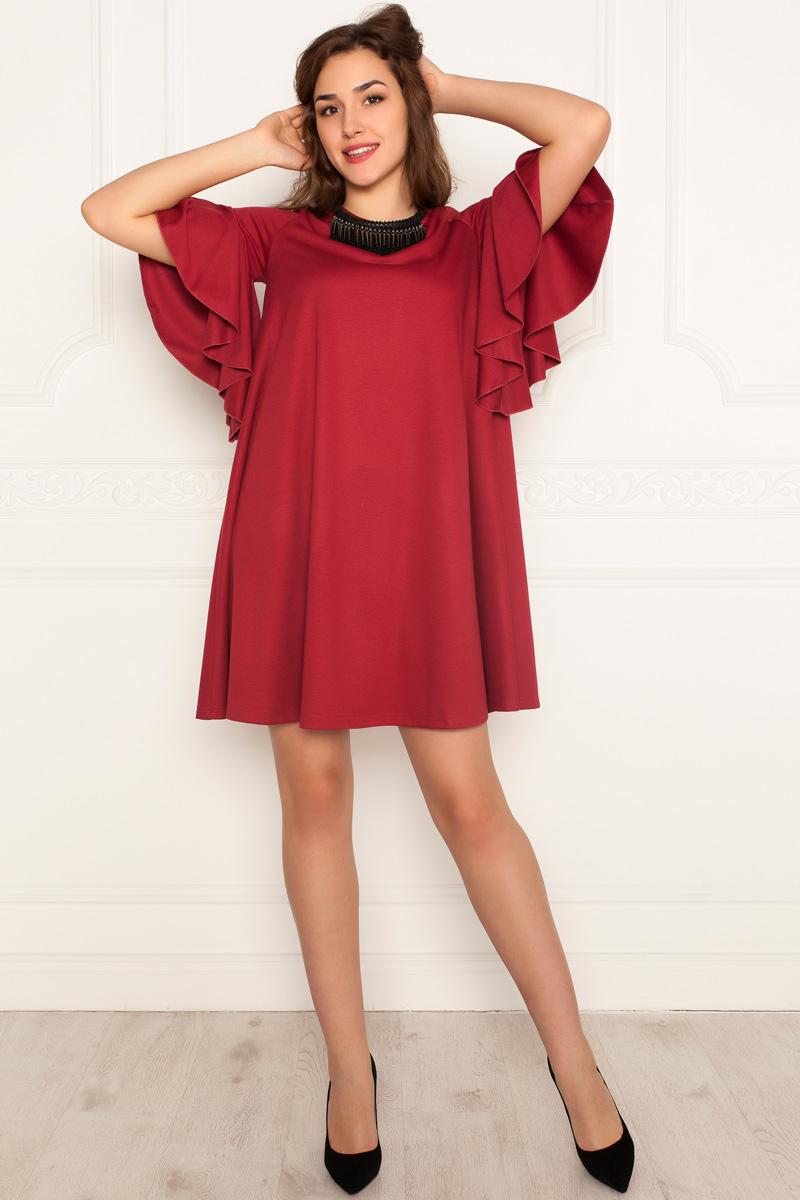 Платье Lautus, цвет: бордовый. 971. Размер 48971Платье от Lautus А-силуэта изготовлено из трикотажа. Втачной рукав длиной до локтевого сгиба декорирован широким воланом. Вырез горловины круглый. Без застежки.