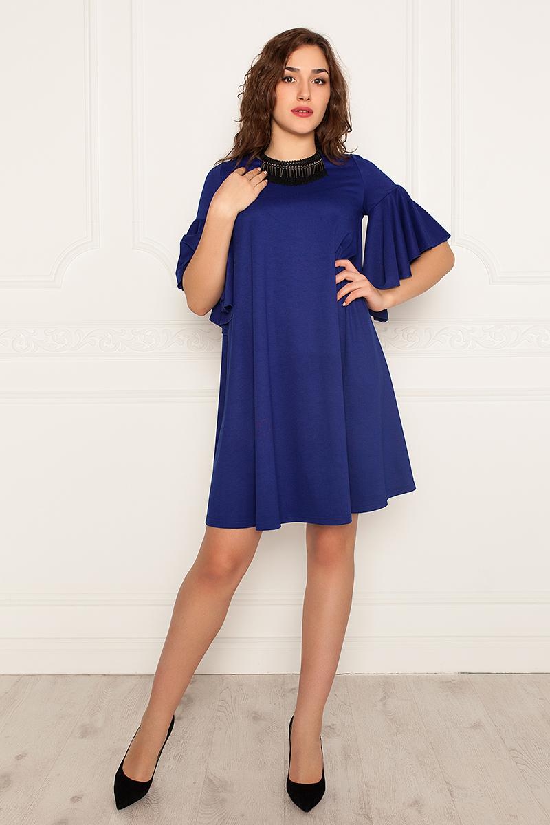 Платье Lautus, цвет: синий. 970. Размер 44970Платье от Lautus А-силуэта изготовлено из трикотажа. Втачной рукав длиной до локтевого сгиба декорирован широким воланом. Вырез горловины круглый. Без застежки.