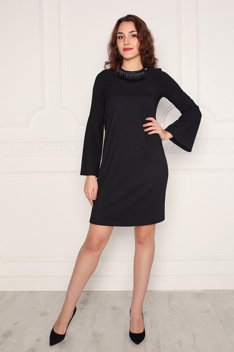 Платье Lautus, цвет: черный. 1003. Размер 501003Платье от Lautus А-силуэта, изготовлено из однотонного трикотажа. Втачной рукав длинный, к низу расклешен. Вырез горловины круглый.