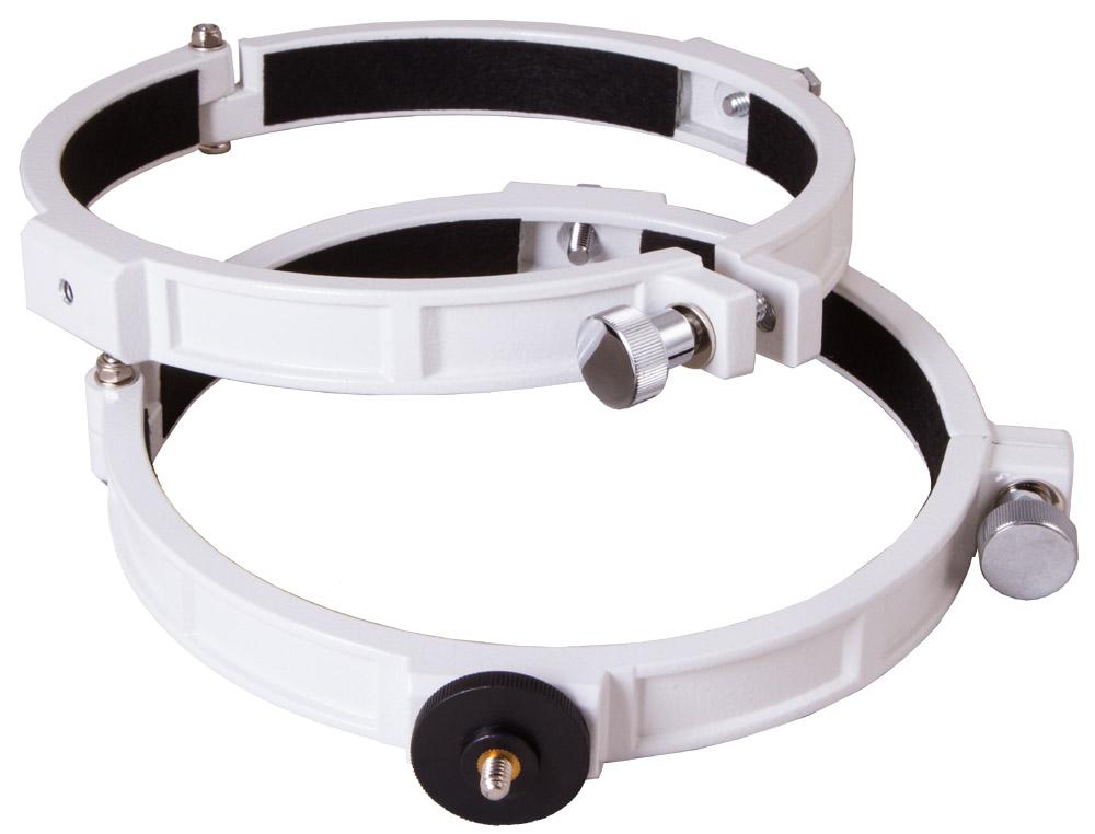 Sky-Watcher 70346 кольца крепежные для рефлекторов 150 мм70346С помощью крепежных колец Sky-Watcher вы сможете зафиксировать оптическую трубу телескопа на монтировке. Эта модель колец предназначена для использования с рефлекторами Ньютона с диаметром объектива 150 мм. Вы сможете установить трубу на любую экваториальную монтировку Sky-Watcher или азимутальную монтировку Sky-Watcher AZ3. Для установки фотокамеры одно из колец имеет стандартное крепление 1/4. Для регулировки степени фиксации трубы применяются стопорные винты.