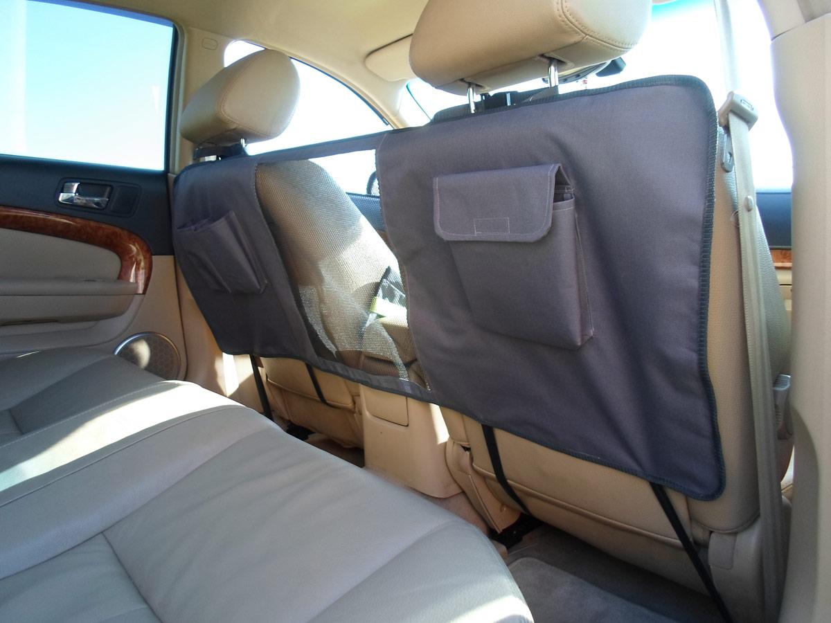 Перегородка защитная для животных AvtoPoryadok, на спинки передних сидений, цвет: серый, 124 х 46 смP17918GrЗащитная перегородка ограничивает передвижение собаки по автомобилю. Прочная и надежная защита спинок сидений от когтей и зубов животного. Полупрозрачная сетка не мешает обзору водителя. Удобные карманы для всяких мелочей вашего питомца. Изготовлена из ткани ПВХ 600 Ден и прочной сетки из полипропилена. Быстрая и простая установка и снятие перегородки. Универсальный размер: 124 на 46 см. Производство: Россия.