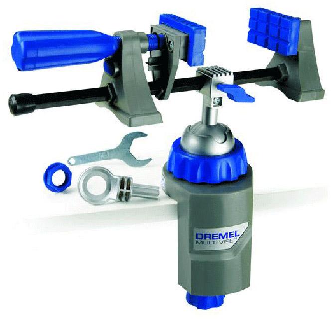 Тиски Dremel Multi-Vise 250026152500JAМногофункциональные тиски Dremel Multi-Vise 2500 - это инструмент 3 в 1: стационарные тиски, отдельный крепежный элемент и зажим для инструмента. Тиски крепятся на любой верстак, рабочую платформу или поверхность толщиной до 6,3 мм. Преимущества:- крепится на любой рабочий стол, платформу или облицовочный материал; - поворачивается на 360° и наклоняется на 50°. Позволяет работать с заготовкой под удобным углом; - губки можно использовать вместе с базовым блоком или отдельно как струбцину; - удобное расположение больших заготовок; - фиксирует большие предметы и защищает хрупкие детали от повреждения; - позволяет работать с круглыми деталями и заготовками неправильной формы; - позволяет быстро удалять предметы из зажима; - обеспечивает большую стабильность; - возможность присоединить фонарь DremeLite. Материал рамы: пластик.Тип тисков: поворотные.Ширина: 190 мм.