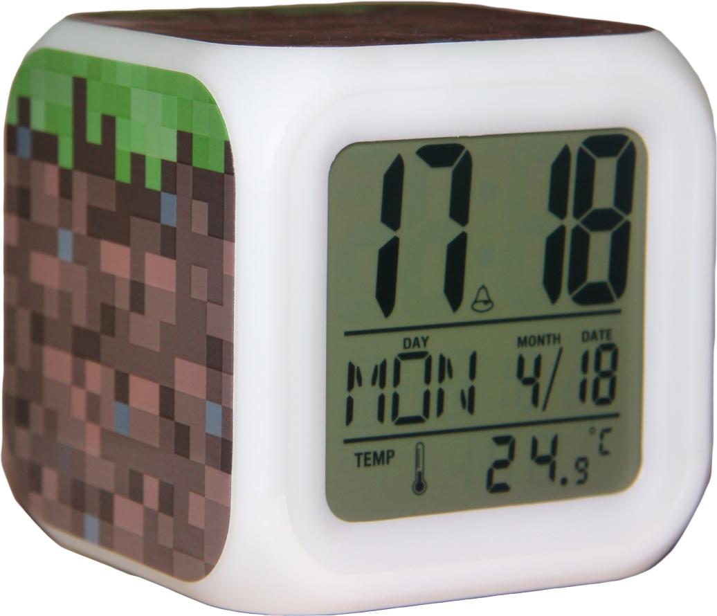 """Настольные часы """"Minecraft"""" своим эксклюзивным дизайном подчеркнут оригинальность интерьера вашего дома. Изделие выполнено в виде блока с надписями """"ТНТ"""".  Часы создающие настроение. Это - светильник, часы, будильник. Семь оттенков мягкой подсветки, термометр и календарь. Все данные отображаются на ЖК-дисплее. Настольные часы Minecraft станут прекрасным аксессуаром для вашего дома, либо прекрасным подарком, который обязательно понравится получателю.  Необходимо докупить 4 батарейки типа ААА (в комплект не входят)."""