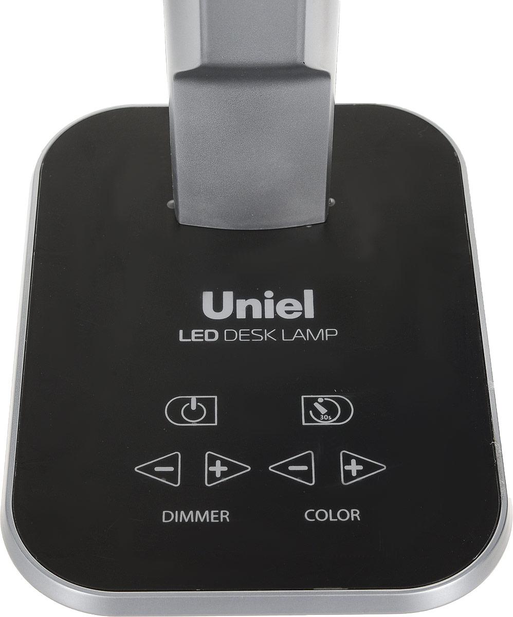 Светильник настольный торговой марки Uniel предназначен только для внутреннего освещения в  жилых или общественных (офисы, магазины) помещениях.  Светильник оборудован сенсорным выключателем с диммером. Направление света регулируется  шарнирной стойкой. Отражатель имеет специальную форму для максимально комфортного  освещения. В качестве источника света в светильнике применяются светодиоды, коэффициент  цветопередачи не менее 70лм/Вт. Светодиодный источник света гарантирует не менее 30 000  часов безупречной работы настольного светильника. Светильник предназначен для работы в  сети переменного тока с номинальным рабочим напряжением 230 В и частотой 50 Гц, при  температуре окружающей среды от 0 до +45°С и относительной влажности не выше 85%.  Продукция сертифицирована и соответствует требованиям нормативных документов.  Характеристики:  Материал корпуса: пластик, металл; Сенсорное управление; Применяемая лампа: светодиод; Световой поток: 900 лм; Цветовая температура: 2700-6400 К; Эквивалентная мощность лампы накаливания: 40 Вт; Упаковка: коробка.