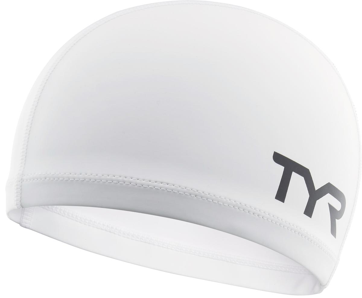 Шапочка для плавания Tyr Silicone Comfort Swim Cap, цвет: белый. LSCCAPLSCCAPШапочка TYR Silicone Comfort Swim Cap сделана из полиэстера, покрытого тонким слоем силикона. Такое сочетание материалов обеспечивает защиту волос от влаги, легкое надевание шапочки, а также комфортное использование в бассейне. Шапочка сделана из трех панелей, что гарантирует точную посадку без складок.