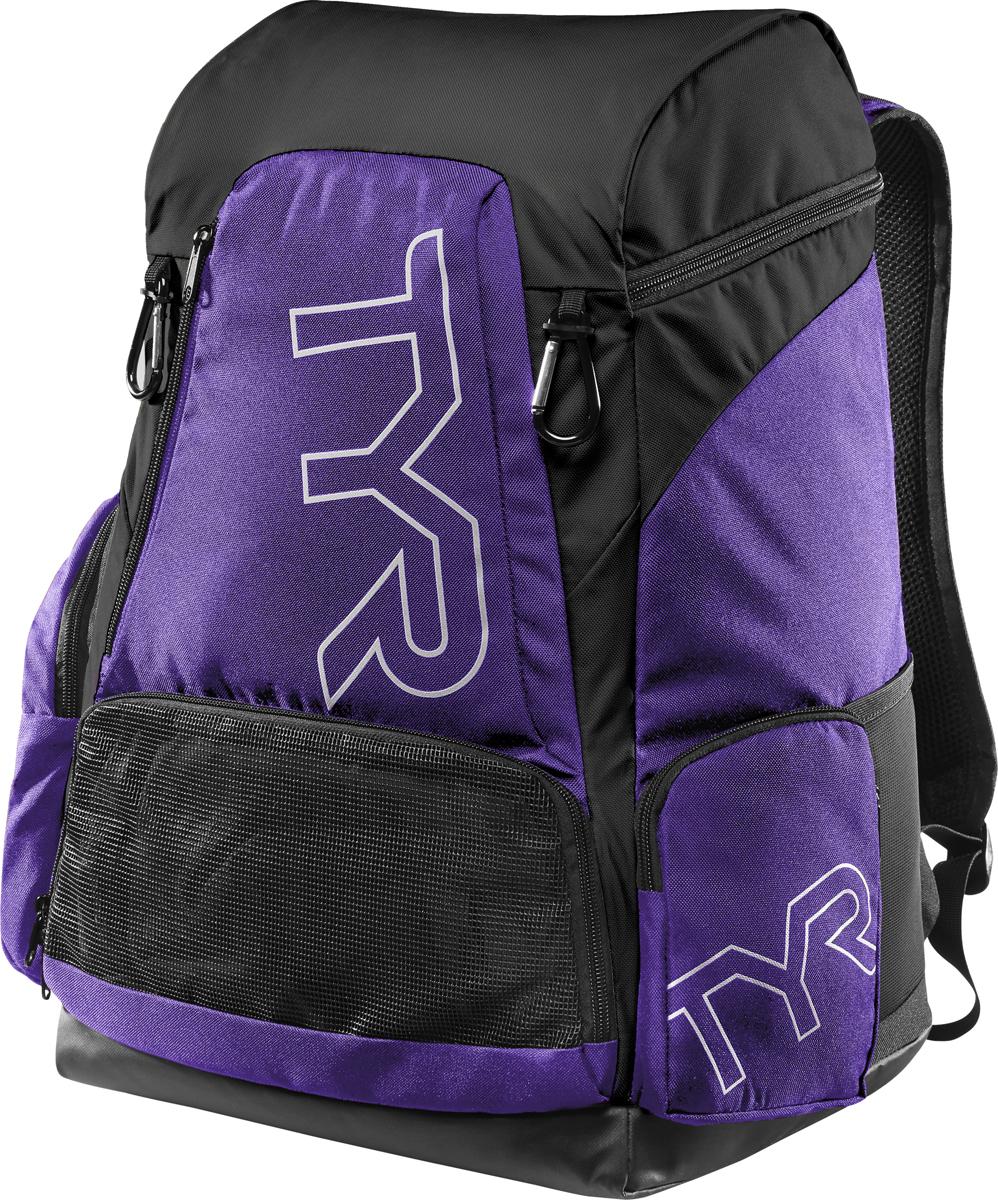 Рюкзак TYR Alliance 45L Backpack, цвет: фиолетовый, черный. LATBP45LATBP45Рюкзак TYR Alliance 45L Backpack – новая версия рюкзака Alliance Team Backpack 2 с более современным дизайном и увеличенным рабочим пространством. Рюкзак сконструирован для пловцов: есть отделение для влажных и сухих вещей, имеются передние и боковые карманы, защитное пространство для крупной электроники, регулируемые ремни, 2 карабина-крючка для подвешивания вещей или сеток. Рюкзак разработан с использованием технологичных тканей, чтобы обеспечить легкость, прочность и водостойкость.