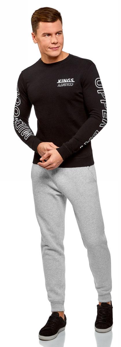 Брюки мужские oodji Basic, цвет: серый меланж. 5B200004M/44312N/2300M. Размер XS (44)5B200004M/44312N/2300MМужские брюки, выполненные из хлопка с добавлением полиэстера, подойдут как для повседневной носки, так и для занятий спортом. Модель на талии имеет широкую эластичную резинку со шнурком-кулиской. Спереди брюки оснащены двумя втачными карманами, сзади одним накладным карманом. Низ брючин дополнен трикотажными манжетами.