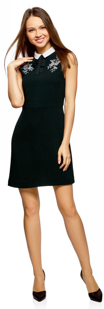 Платье oodji Ultra, цвет: черный, кремовый. 12C13002/43299/2930P. Размер 44-170 (50-170)12C13002/43299/2930PСтильное платье, выполненное из высококачественного материала, отлично дополнит ваш гардероб. Модель без рукавов с отложным воротником на спинке дополнено застежкой-молнией. Спереди модель оформлено изящной вышивкой.