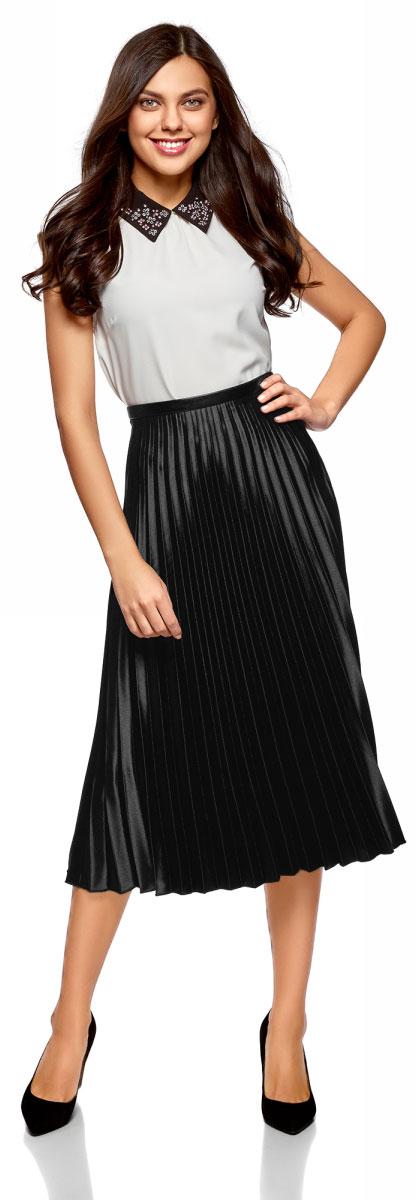 Юбка oodji Ultra, цвет: черный. 13G06001/22112/2929B. Размер 34-170 (40-170)13G06001/22112/2929BСтильная плиссированная юбка, выполненная из эластичного полиэстера, станет отличным дополнением вашего гардероба. Модель миди-длины на талии имеет эластичный пояс.