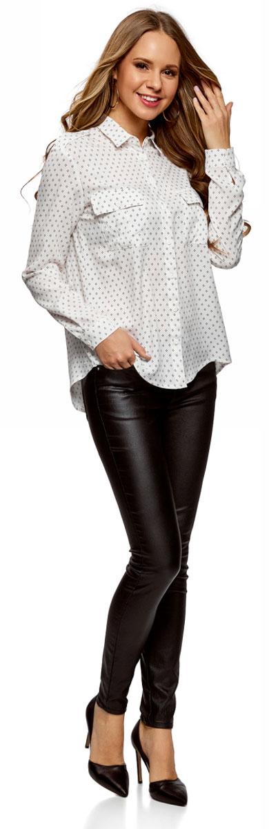 Блузка женская oodji Ultra, цвет: кремовый, черный. 11411127B/26346/3029G. Размер 44-170 (50-170)11411127B/26346/3029GОригинальная женская блузка oodji Ultra выполнена из качественной вискозы. Модель с отложным воротником и длинными рукавами застегивается спереди на пуговицы. Манжеты рукавов также имеют застежки-пуговицы. Плечи блузки дополнены хлястиками на пуговицах, спереди изделие оформлено двумя накладными карманами с клапанами. Спинка блузки немного удлинена.