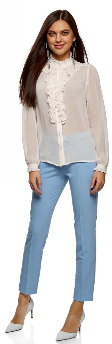 Блузка женская oodji Ultra, цвет: белый. 11411183/15036/1200N. Размер 40-170 (46-170)11411183/15036/1200NСтильная женская блузка выполнена из полупрозрачного текстиля. Модель с воротником-стойкой, оформленным рюшей и длинными рукавами, застегивается на пуговицы.
