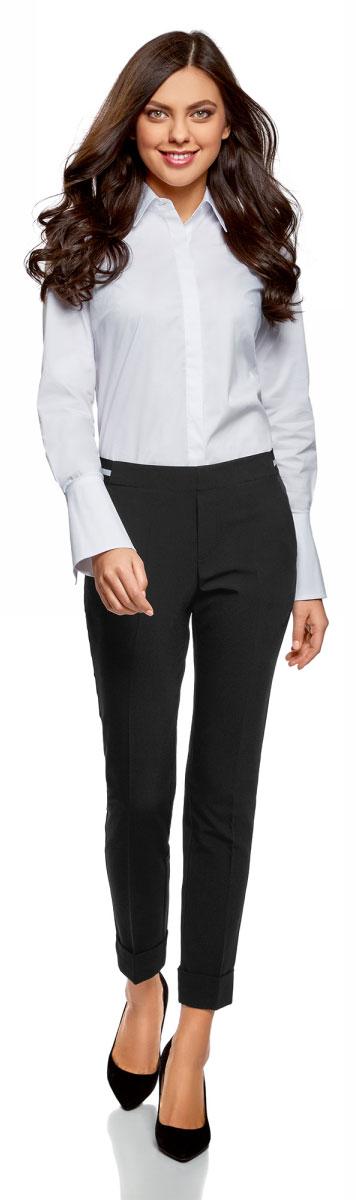 Брюки женские oodji Ultra, цвет: черный. 11703057-12/18600/2900N. Размер 36-170 (42-170)11703057-12/18600/2900NЗауженные женские брюки, выполненные из комбинированного материала, отлично дополнят ваш гардероб. Модель в поясе имеет застежку-крючек и ширинку на молнии. Также пояс дополнен эластичной резинкой. Сзади модель оформлена имитацией карманов, а спереди двумя врезными карманами.