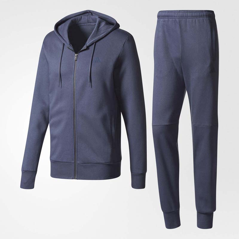 Спортивный костюм мужской Adidas Co Mvp Ts, цвет: синий. BQ8458. Размер 50BQ8458Мужской спортивный костюм от Adidas выполнен из мягкого хлопкового флиса. Костюм состоит из толстовки и брюк. Толстовка классического кроя с втачными рукавами и капюшоном застегивается на молнию и дополнена боковыми карманами. Зауженные брюки с мягкой резинкой в поясе также дополнены боковыми карманами. По низу брючин предусмотрены трикотажные манжеты.Такой костюм обеспечит вам комфорт в течение всего дня.