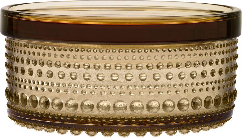 Ваза Iittala Kastehelmi, цвет: коричневый, 11,1 х 5,7 см1015374Ассортимент Kastehelmi это изделия из стекла, которые были созданы в 1964 году. Чтобы отпразновать 50-летие сотрудничества с финским художником по цветному стеклу Ойва Тойкка компания Iittala в 2010 году отобрала наиболее популярные его работы. Тойкка решил проблему как скрыть дефекты серийного производства стеклянных предметов. Так появилась идея украсить продукцию капельками стекла.
