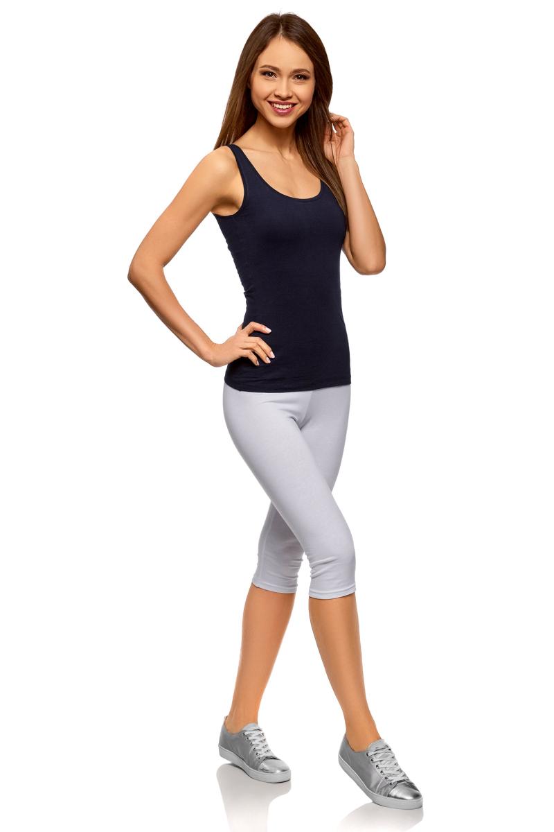 Капри женские oodji Ultra, цвет: белый. 18700055B/46159/1000N. Размер XL (50)18700055B/46159/1000NУдобные женские капри, выполненные из эластичного хлопка, отлично подойдут для занятия спортом. Модель облегающего кроя, на поясе имеют эластичную широкую резинку.