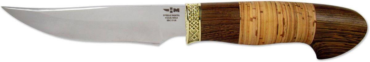 Нож охотничий Ножемир Жиган, цвет: бежевый, темно-коричневый, длина клинка 13,2 смЖИГАН (7353)нЦельнометаллический нож из нержавеющей стали изготавливается на собственном предприятии компании Ножемир, расположенном в городе Ворсма, Нижегородской области. Качественный режущий инструмент без особого труда справится с разделкой рыбы, мяса или обрезанием веток. Нож ЖИГАН выполнен из нержавеющей стали. Удобная рукоять обуславливает комфортную эксплуатацию в самых различных условиях. Привлекательный внешний вид режущего инструмента в сочетании с его отличной функциональностью предопределяют популярность ножа среди большого числа покупателей. В комплектации поставляются ножны из натуральной кожи насыщенного коричневого цвета.