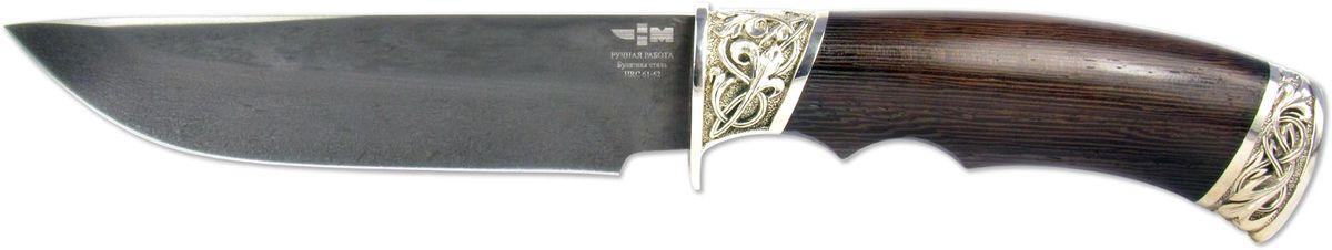 Нож охотничий Ножемир Лесник, цвет: темно-коричневый, длина клинка 14,2 смЛЕСНИК (6332)бНож Лесник имеет вид наградного или подарочного ножа. Нож производит впечатление качественной и дорогой вещи. Клинок этой модели выполнен из легендарной булатной стали и имеет красивый своеобразный рисунок. Рукоятка ножа выполнена из дерева породы венге. Отдельно стоит остановиться на оковке и тыльнике ножа, которые выполнены из мельхиора и украшены резным орнаментом. Такой нож может украсить любую коллекцию, а может стать настоящим повседневным помощником для тех, кто много времени проводит на охоте, рыбалке или в турпоходе. Для того чтобы обеспечить максимальное удобство использования ножа в полевых условиях, в комплекте есть ножны из натуральной кожи.