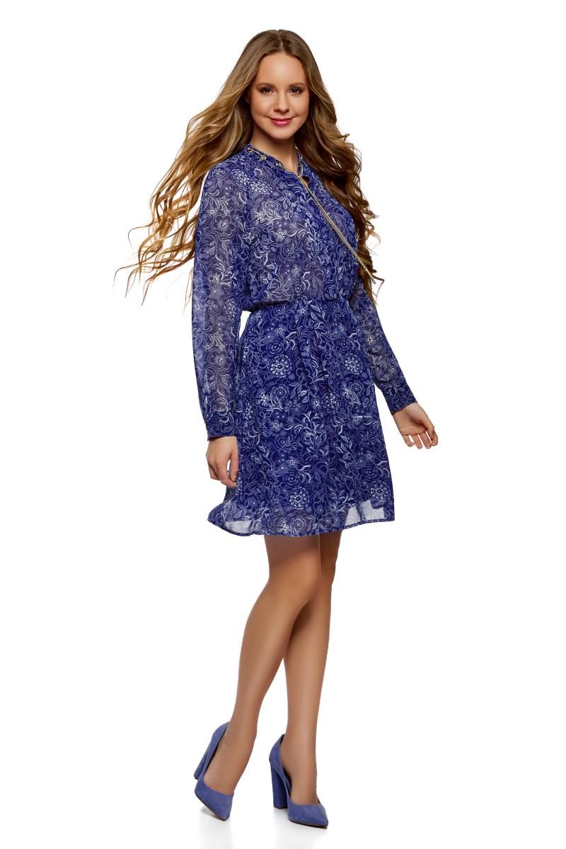 Платье oodji Collection, цвет: синий, голубой. 21912003/38375/7570F. Размер 42-164 (48-164)21912003/38375/7570FСтильное платье, выполненное из струящейся ткани, отлично дополнит ваш гардероб. Модель с длинными рукавами и V-образным вырезом горловины в поясе дополнена эластичной резинкой. Горловина декорирована цепочкой, проходящей через металлические люверсы.
