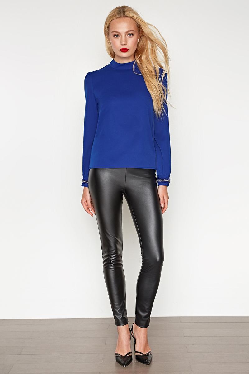 Блузка женская Concept Club Ciel, цвет: синий. 10200260210_500. Размер L (48)10200260210_500Стильная блузка, выполненная из высококачественного легкого материала, отлично дополнит ваш гардероб. Модель свободного кроя с воротником-стойкой и длинными рукавами-фонариками на спинке имеет застежку на пуговицы. Манжеты декорированы отделкой из цепочки и бусин.