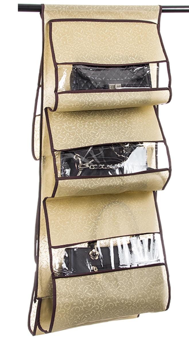 Кофр подвесной для сумок El Casa Золотой узор, 5 секций, 40 х 90 см370760Кофр подвесной для сумок с 5 прозрачными секциями изготовлен из высококачественного материала. В шкафу всегда будет порядок, так как кофр для сумок не только очень компактен, но и, несмотря на свои размеры, вмещает множество вещей. Пять секций, расположенных с двух сторон, позволят вам удобно разместить свои сумочки, полотенца, зонтики и многое другое в легкодоступном месте.