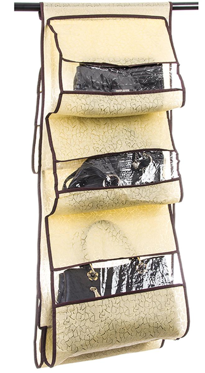 Кофр подвесной для сумок El Casa Песочная мозаика, 5 секций, 40 х 90 см370761Кофр подвесной для сумок с 5 прозрачными секциями изготовлен из высококачественного материала. В шкафу всегда будет порядок, так как кофр для сумок не только очень компактен, но и, несмотря на свои размеры, вмещает множество вещей. Пять секций, расположенных с двух сторон, позволят вам удобно разместить свои сумочки, полотенца, зонтики и многое другое в легкодоступном месте. Размер 40х90 см.Кофр подвесной для сумок 40*90 см. EL Casa Песочная мозаика 5 секций