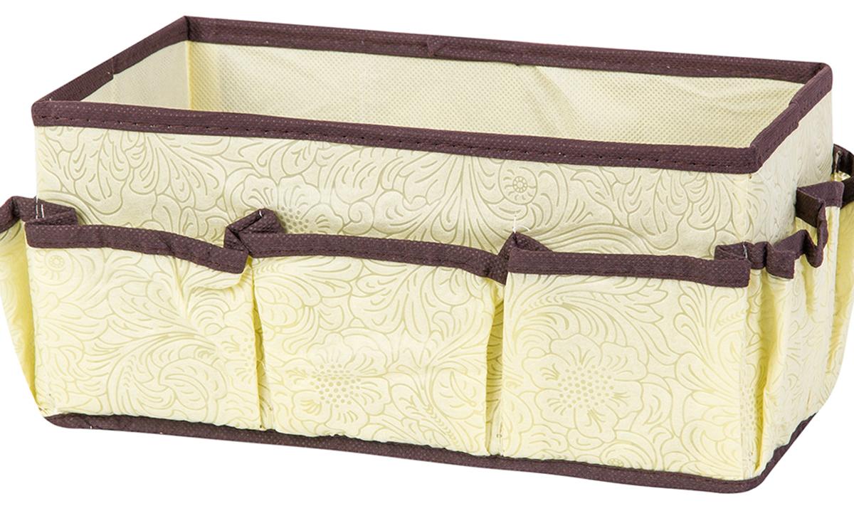 Органайзер для косметики и мелочей El Casa Цветы на золотом, с 7 карманами, 25 х 15 х 12 см370879Удобный и компактный органайзер с 7 карманами с легкостью вместит все необходимые баночки и тюбики. Большое основное отделение можно использовать для кремов, парфюмерии и лаков. Изготовлен из высококачественного нетканого материала. Наличие различных кармашков делает возможным хранение декоративной косметики.Размер: 25 х 15 х 12 см.