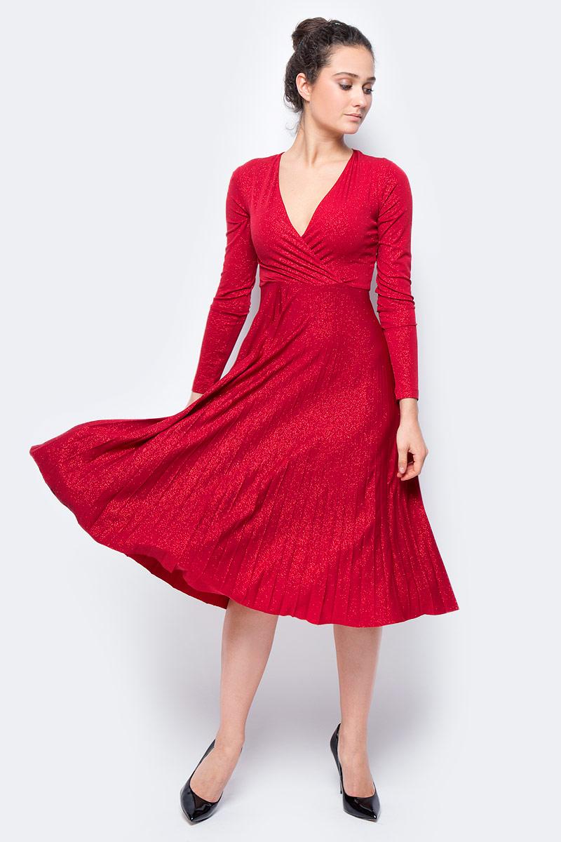 Стильное_платье_длины_ниже_колен_выполнено_из_100%25_полиэстера._Модель_с_длинными_рукавами_и_V-образным_вырезом_горловины_отлично_дополнит_ваш_гардероб._Платье_на_спинке_имеет_застежку-молнию.