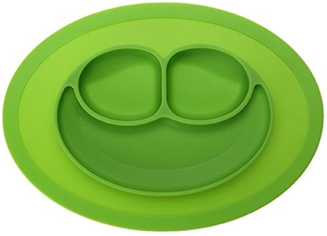 Тарелка детская FidgetGo Улыбка, цвет: зеленый, диаметр 17,5 см2212345678146Тарелка благодаря силиконовому дну прилипает к столу и другим равномерным поверхностям, предотвращая беспорядок на кухне. Недоеденная еда так и останется на тарелке или пространстве вокруг нее, не испачкав стол и кухню. Перевернуть тарелку также невозможно, что действительно помогает экономить мамин труд. Детская посуда изготовлена из качественного пищевого силикона, абсолютно гипоаллергенного и безопасного. Еще одной приятной особенностью силиконовых тарелок для детей является то, что их можно мыть в посудомоечной машинке, разогревать в микроволновой печи, что обычно не предусмотрено при использовании других детских тарелочек. Весёлая форма тарелки поднимет настроение вашему ребенку.