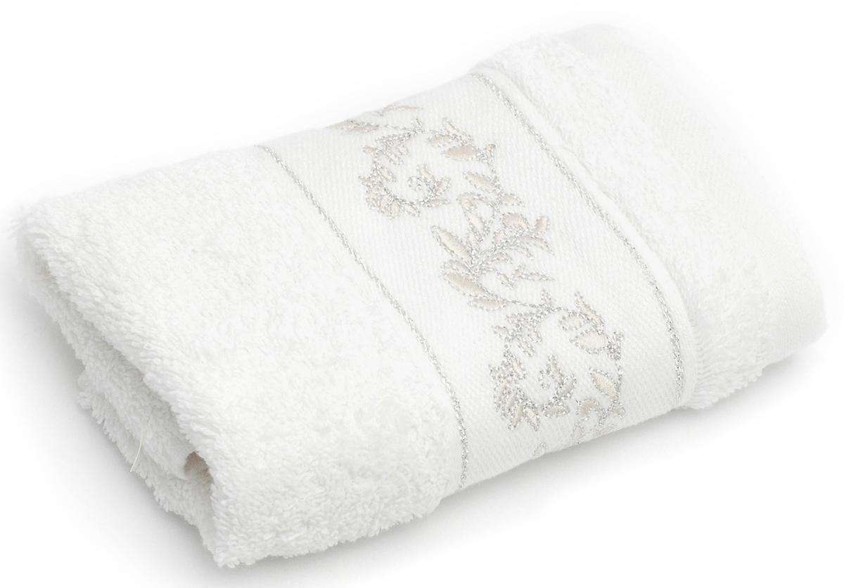 Полотенце для ванной Wess, 30х50 см, EleganceL01-14Вышивка из вискозной нити с серебристым люрексом в сочетании с нежным кремовым оттенком подчеркнет безупречность вашего вкуса. Произведено в Португалии из длинноволокнистого хлопка премиум-сортов. Особая пряжа обладает отличными водопоглощающими свойствами, гипоаллергенностью, мягкостью и объемом. Полотенце имеет удобную бренд-петельку.Плотность материала 500 г/кв. м. Полотенца надлежащего качества возврату и обмену не подлежат.