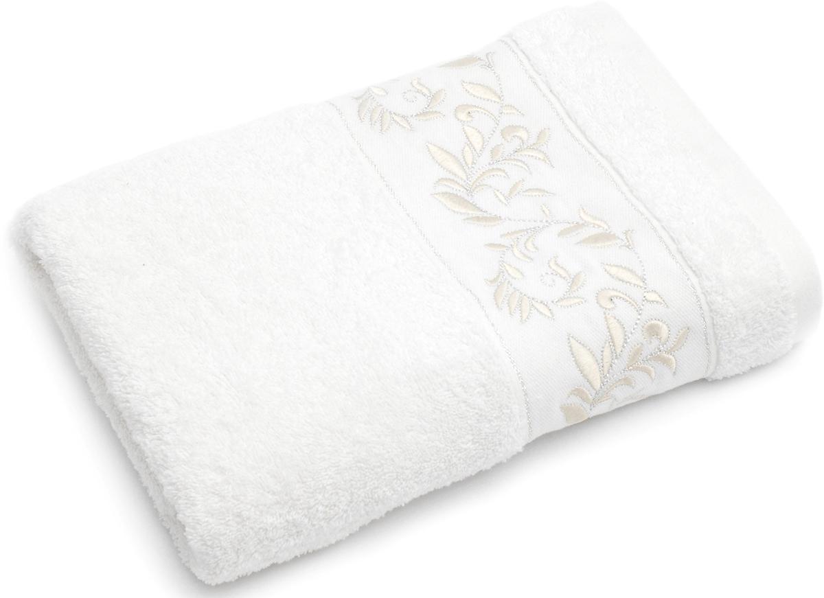 Полотенце для ванной Wess Elegance, цвет: белый, 70 х 140 смL03-14Вышивка из вискозной нити с серебристым люрексом в сочетании с нежным кремовым оттенком подчеркнет безупречность вашего вкуса. Произведено в Португалии из длинноволокнистого хлопка премиум-сортов. Особая пряжа обладает отличными водопоглощающими свойствами, гипоаллергенностью, мягкостью и объемом. Полотенце имеет удобную бренд-петельку.Плотность материала 500 г/кв. м.